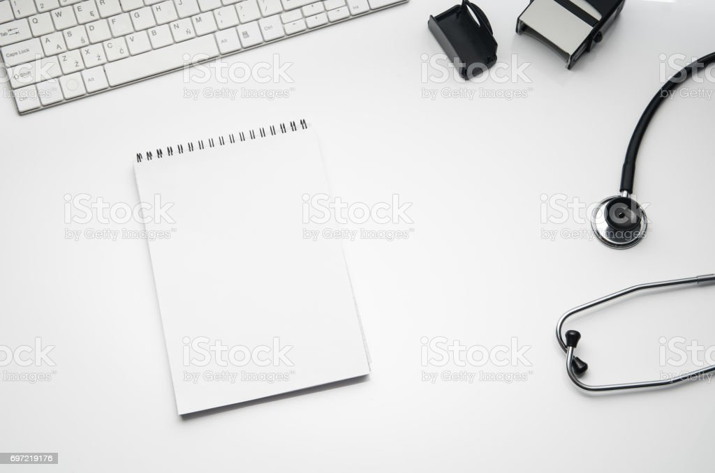Doctor's desk with medical accessories and products. Top view photograph stock photo