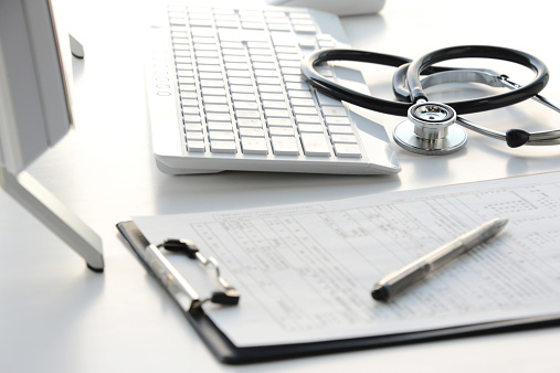 istock Doctor's desk with stethoscope, clipboard, and computer  465480220