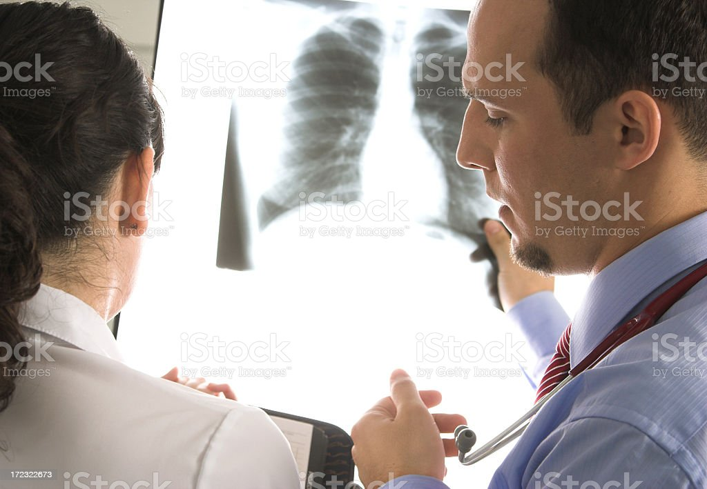 Doctors discussing patient's case based on x-ray imagery  stock photo