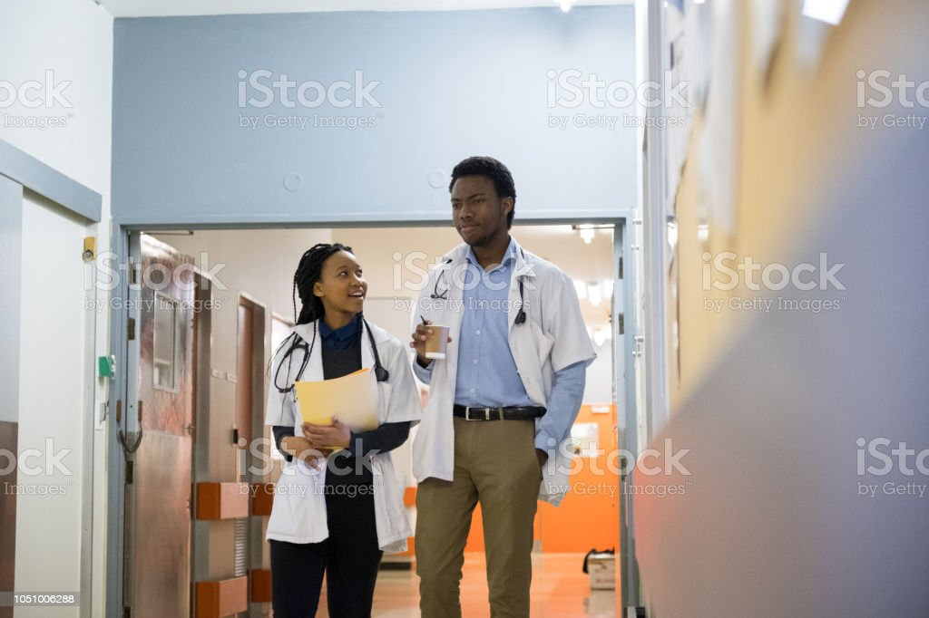 Doctors discussing patients records stock photo