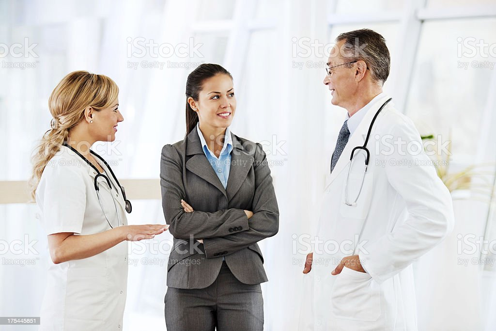 Doctors discussing with patient. royalty-free stock photo