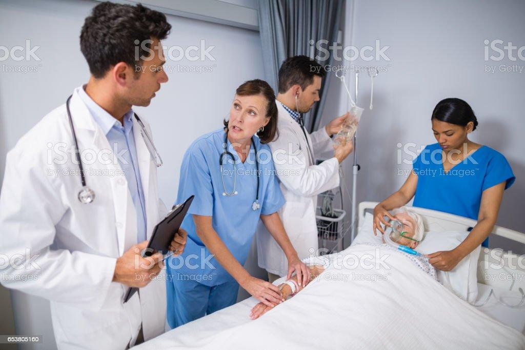 Doctors examining senior patient stock photo