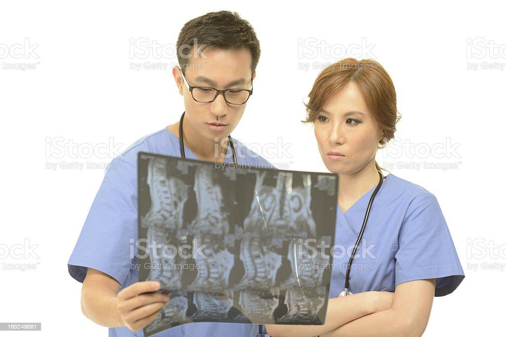 Doctors examining the MRI scan royalty-free stock photo