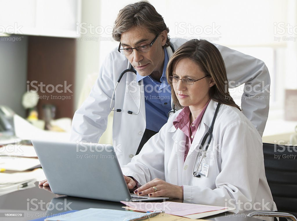 Doctors going over records royalty-free stock photo