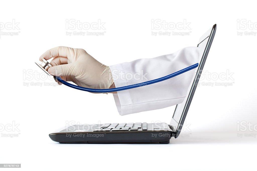 Doctor's Hand from the Computer's Display stock photo