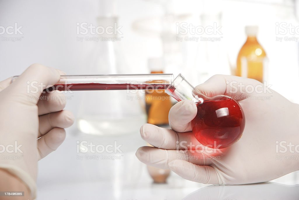 Doctor's hand in glove with blood royalty-free stock photo