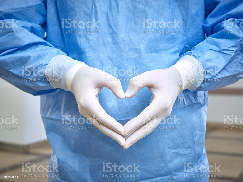Doctor's hands forming a heart shape stock photo