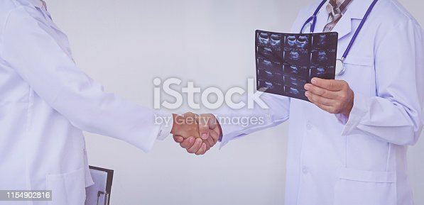 istock Doctors holding a clipboard with prescription, concept teamwork 1154902816