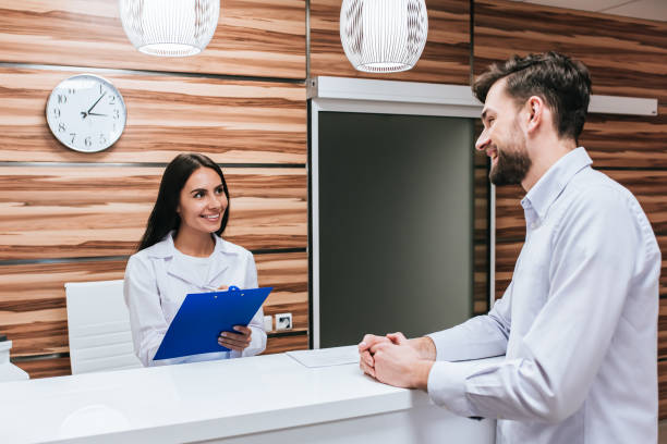 doctors in ophthalmology clinic - receptionist stock photos and pictures
