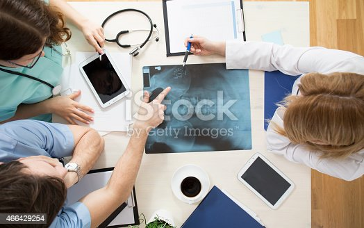 istock Doctors interpreting x-ray image 466429254
