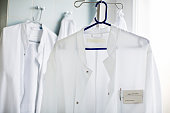 Doctor's lab coat on hanger in laboratory