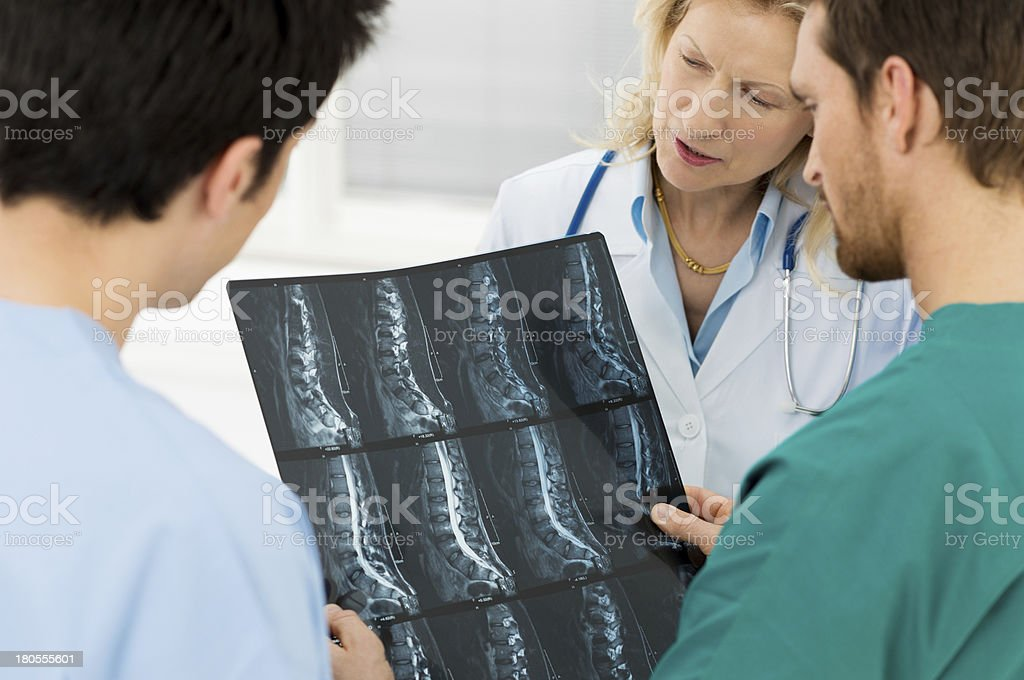 Doctors looking at a patients X-rays stock photo
