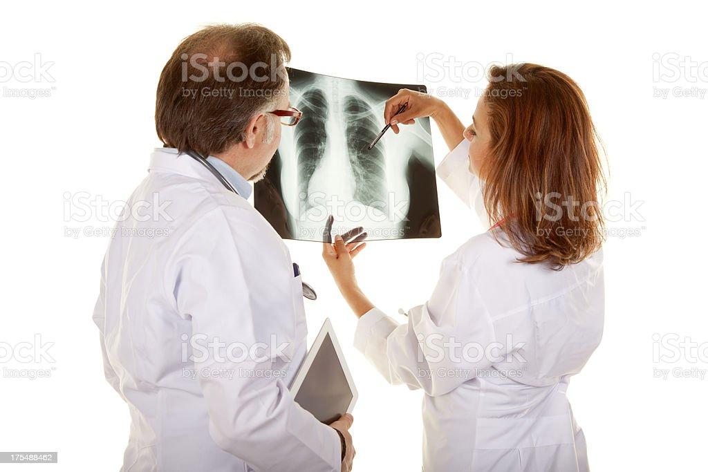 Doctors looking  X-ray stock photo
