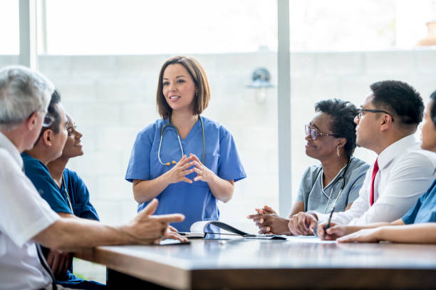 doctors meeting - hospital stock pictures, royalty-free photos & images