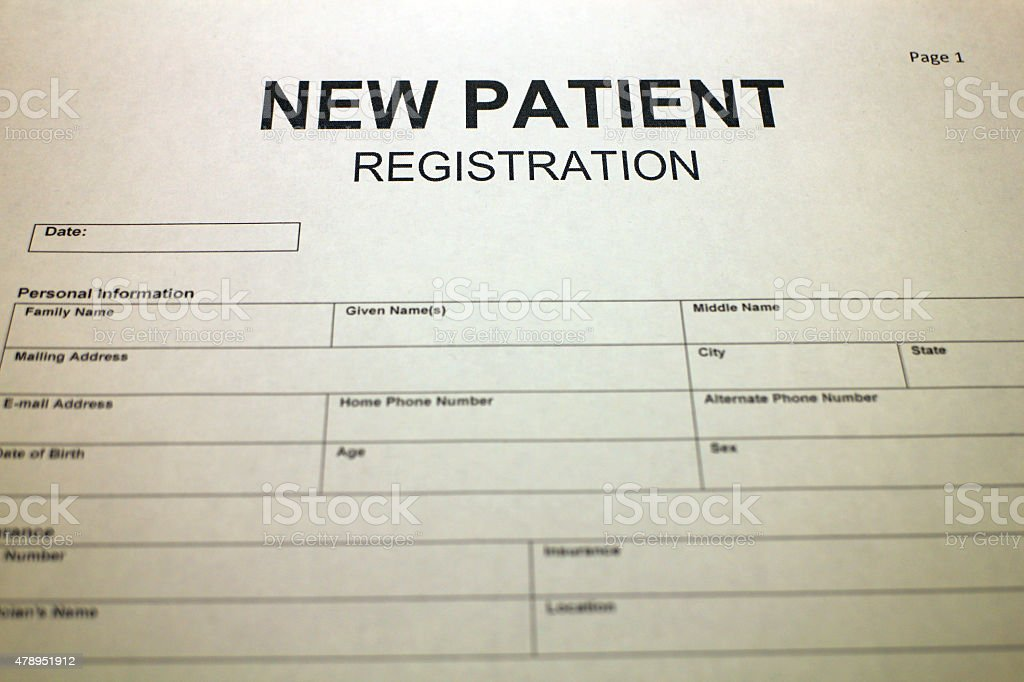 Someone filling out New Patient Registration Form.