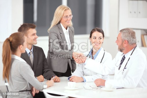 Doctors on business meeting.See more BUSINESS images with this GROUP of PEOPLE. For lightbox click any image below.