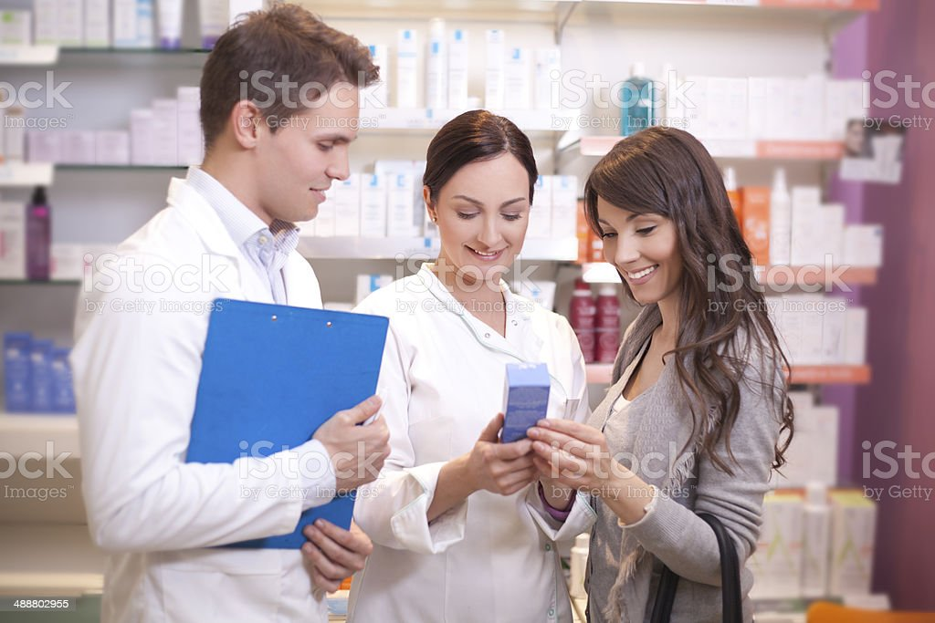 Doctors pharmacist with customer royalty-free stock photo