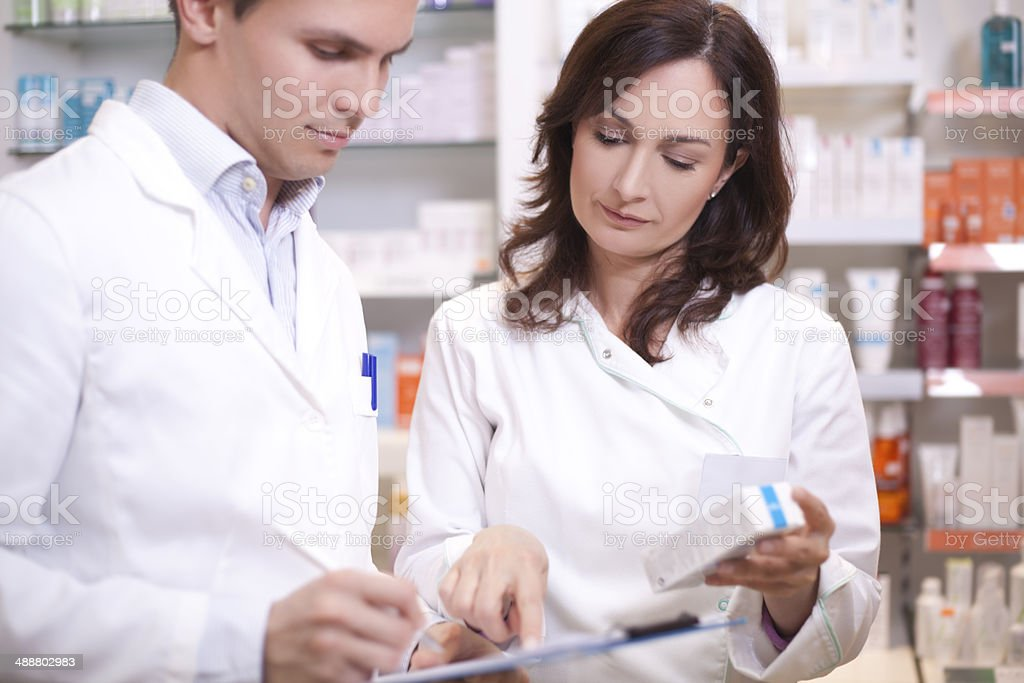 Doctors pharmacists at work royalty-free stock photo