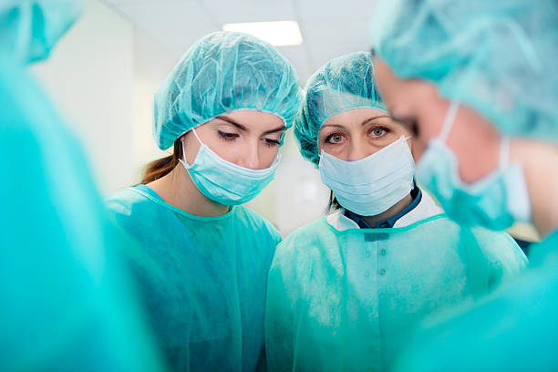 Doctors preparing for surgery stock photo