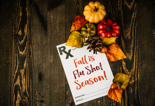 Doctor's prescription note with flu shot reminder for fall Doctor's prescription note with flu shot reminder for fall flu shot stock pictures, royalty-free photos & images