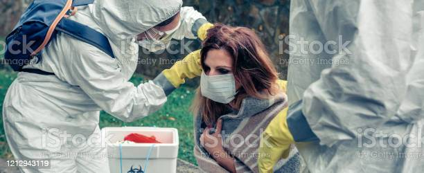 Doctors putting protective mask on woman infected with a virus picture id1212943119?b=1&k=6&m=1212943119&s=612x612&h=rbkjxqlfuyh1lvt1qxeo37trovgzuyxwpgj7vgvm3wa=