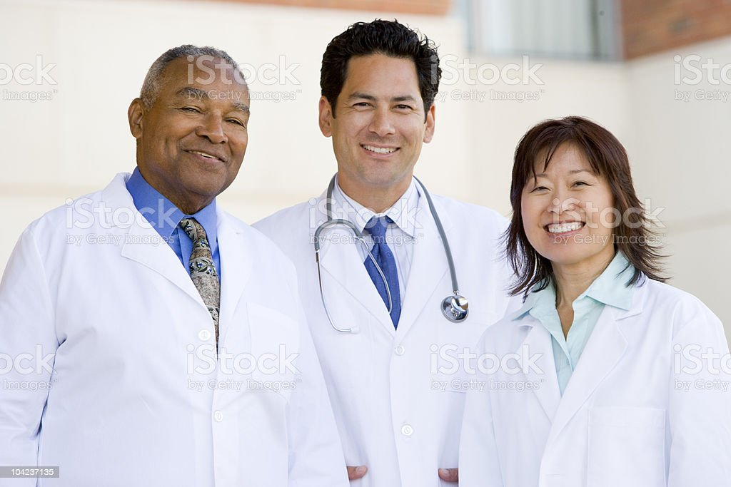 Doctors Standing Outside A Hospital stock photo