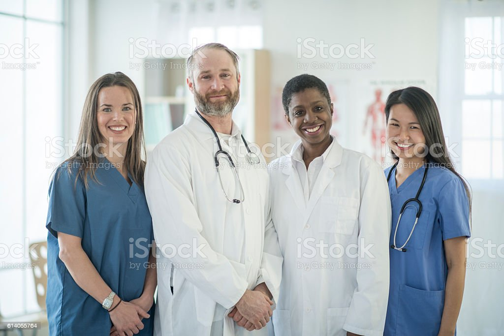 Doctors Standing with Their Staff stock photo