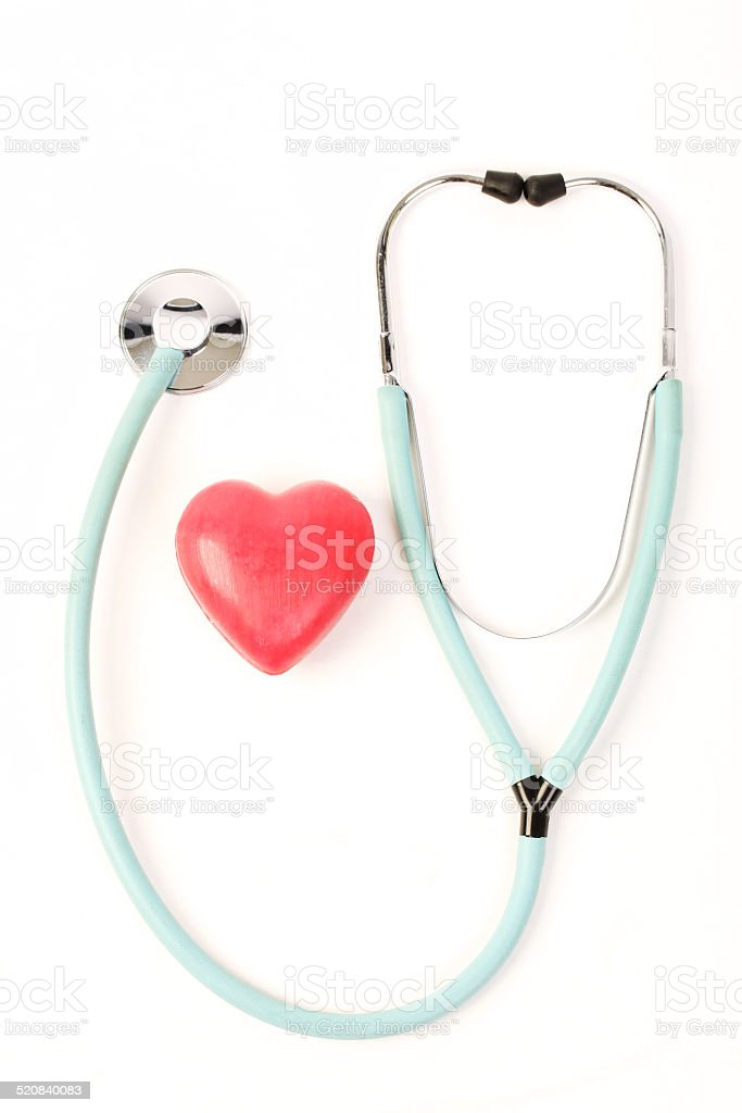 Doctors stethoscope and one red heart on white background stock photo