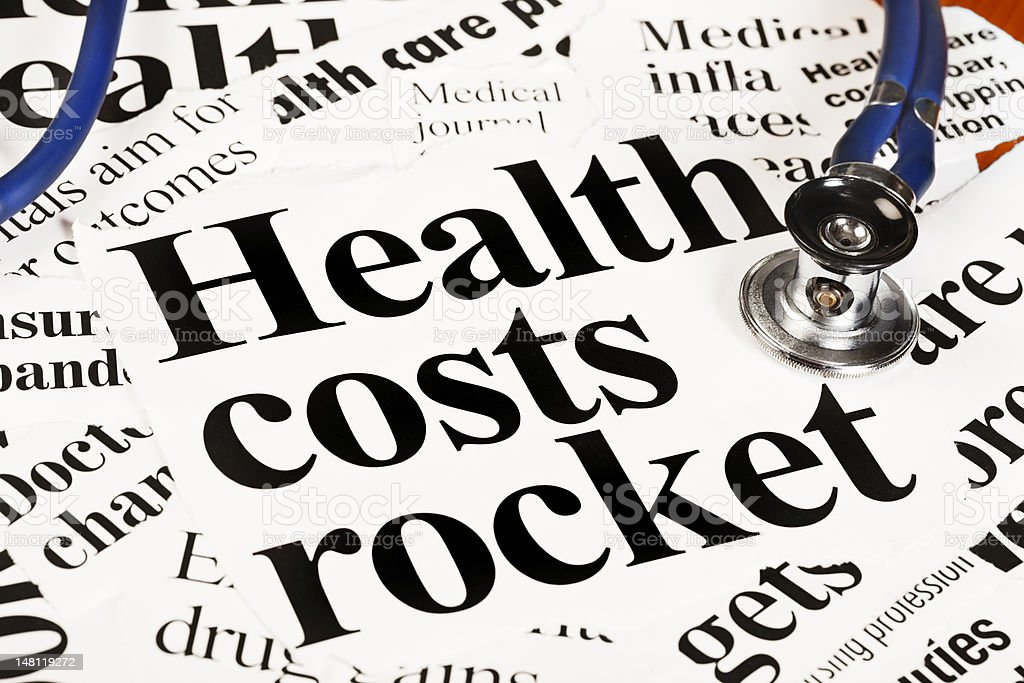 Doctor's stethoscope sits on headlines about rocketing health costs royalty-free stock photo