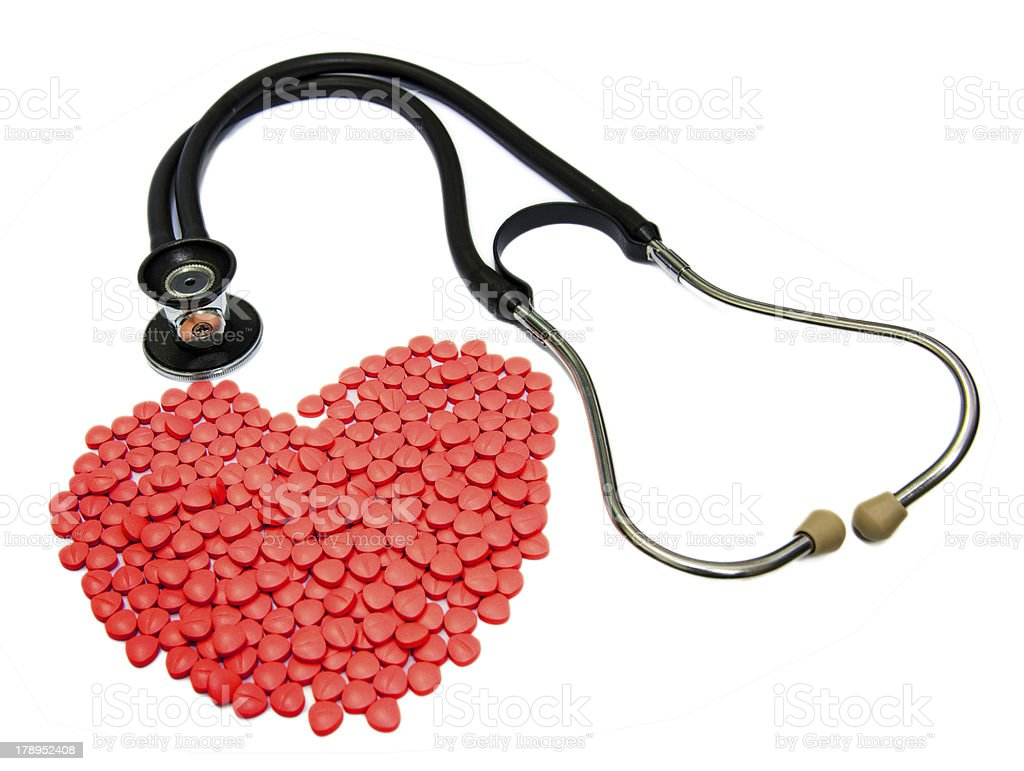 Doctors Stethoscope With red Drugs In Pill Form royalty-free stock photo
