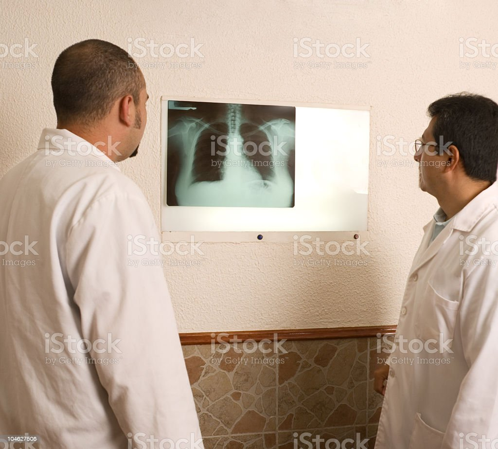Doctors studying x-ray of lungs royalty-free stock photo