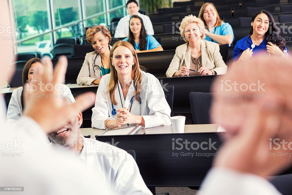 Doctors, surgeons, medical students attending medical conference seminar stock photo