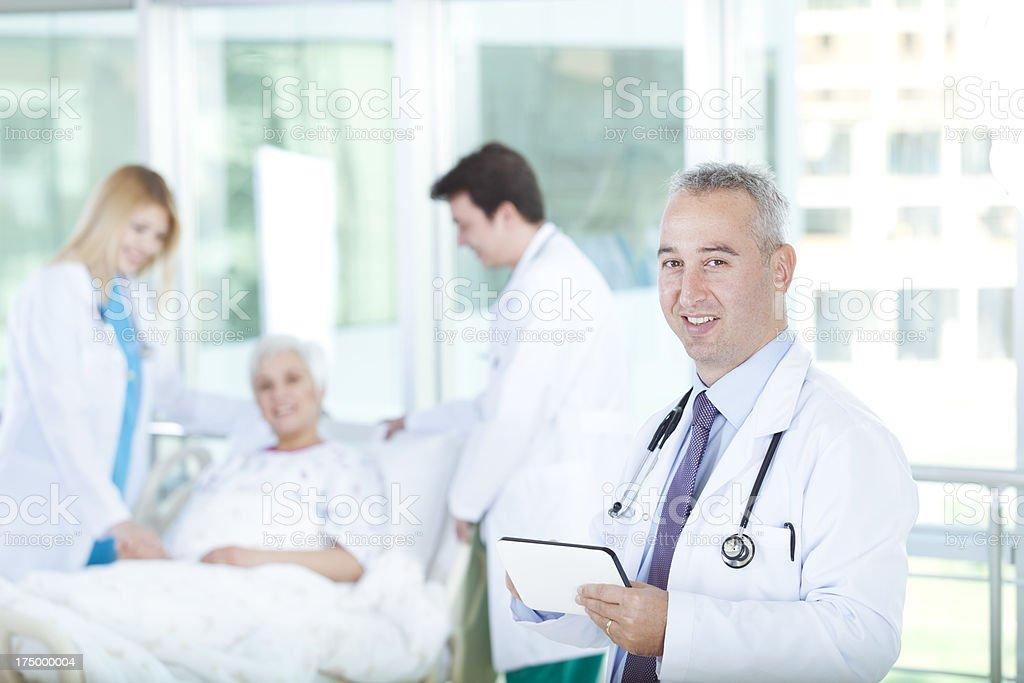 Doctors  Talking Senior Patient royalty-free stock photo