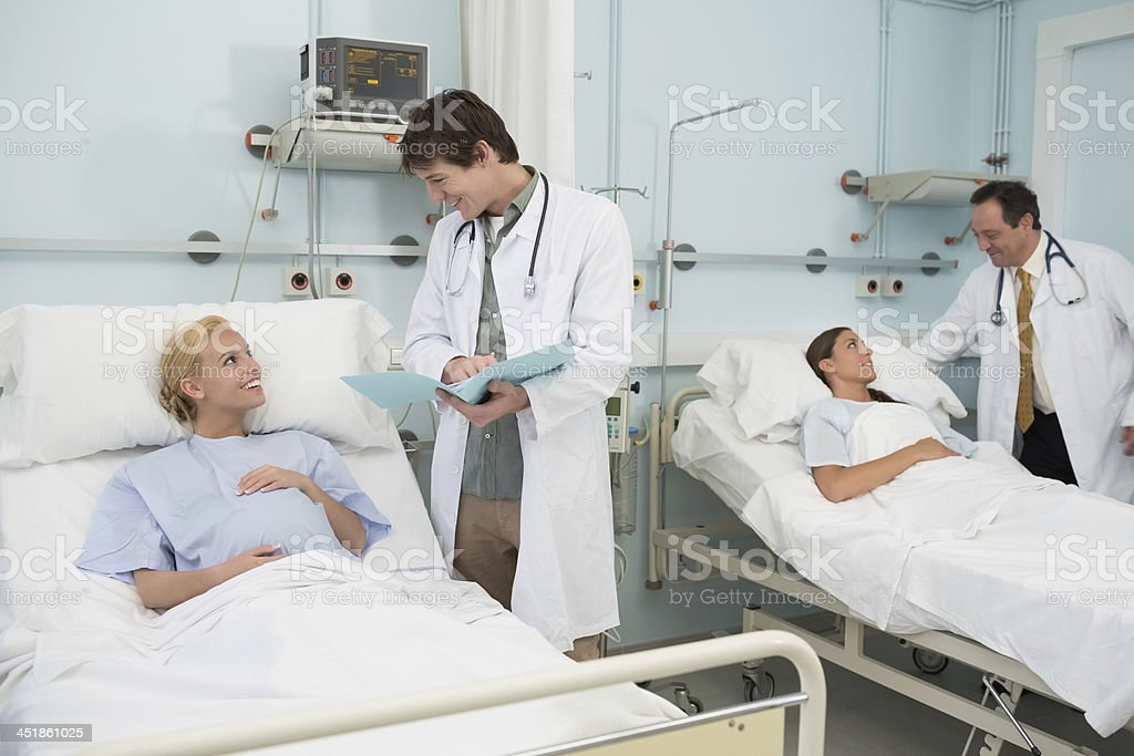Doctors talking to female patients royalty-free stock photo
