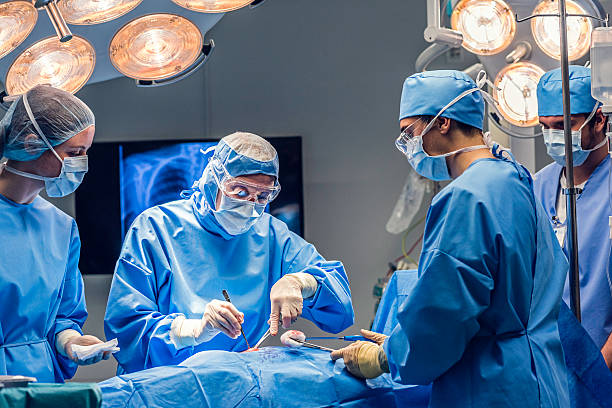 Doctors team in operating room stock photo