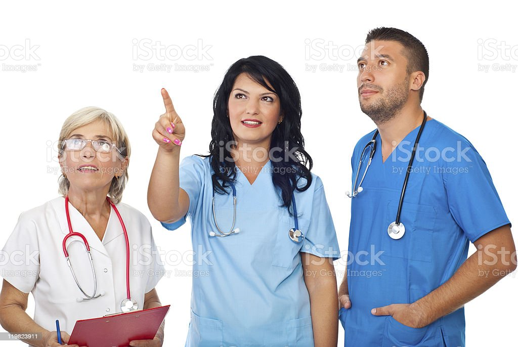Doctors team looking up royalty-free stock photo