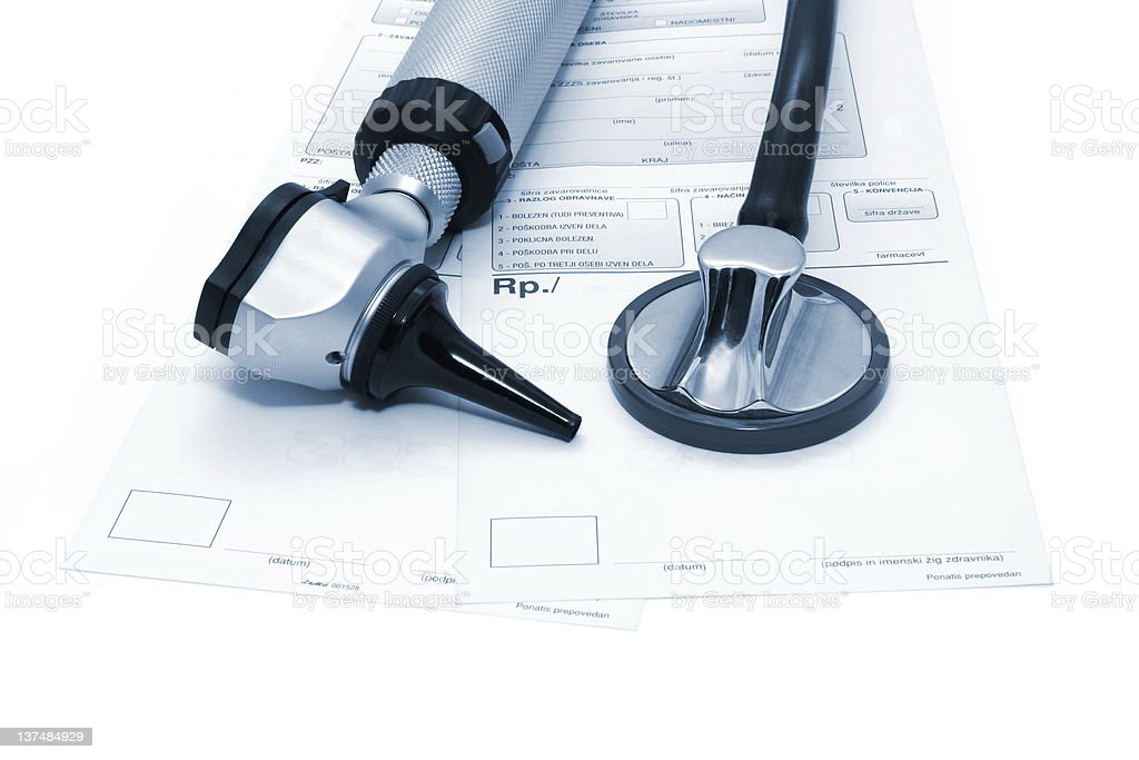 Doctors tools...Stethoscope and otoscope on a prescriptions royalty-free stock photo