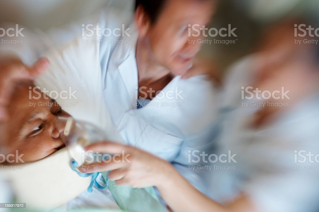 Doctors treating woman for a heart attack royalty-free stock photo