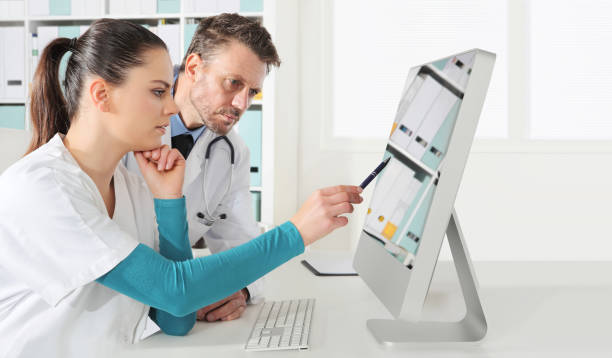 doctors use the computer, concept of medical consulting - assistant stock pictures, royalty-free photos & images