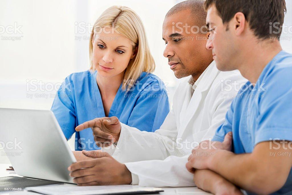 Doctors using computer. stock photo