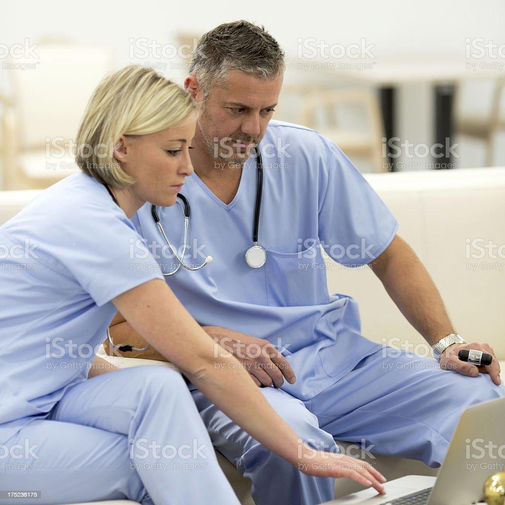 Doctors using laptop stock photo