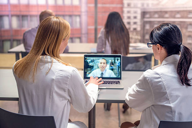 doctors video conference - video still stock pictures, royalty-free photos & images