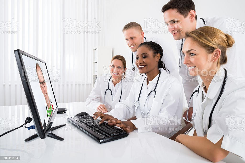 Doctors Videoconferencing On Computer stock photo