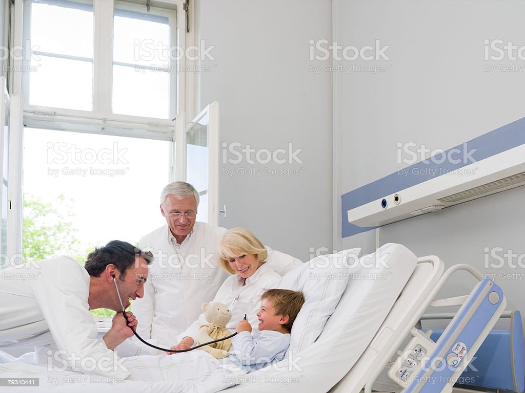 Doctors with a patient 免版稅 stock photo