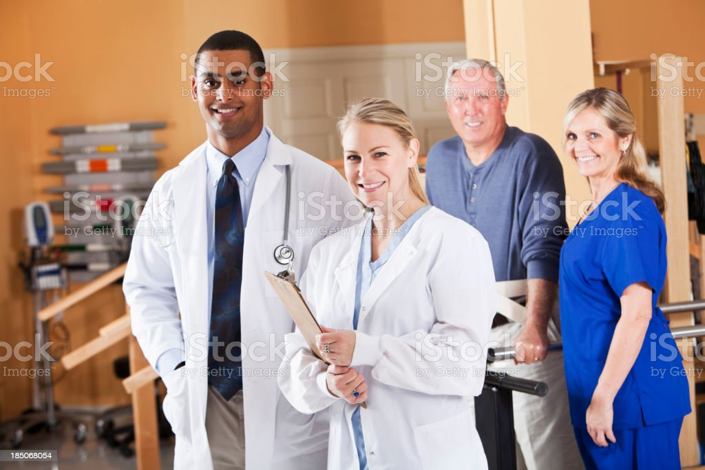 Doctors with physical therapy patient royalty-free stock photo