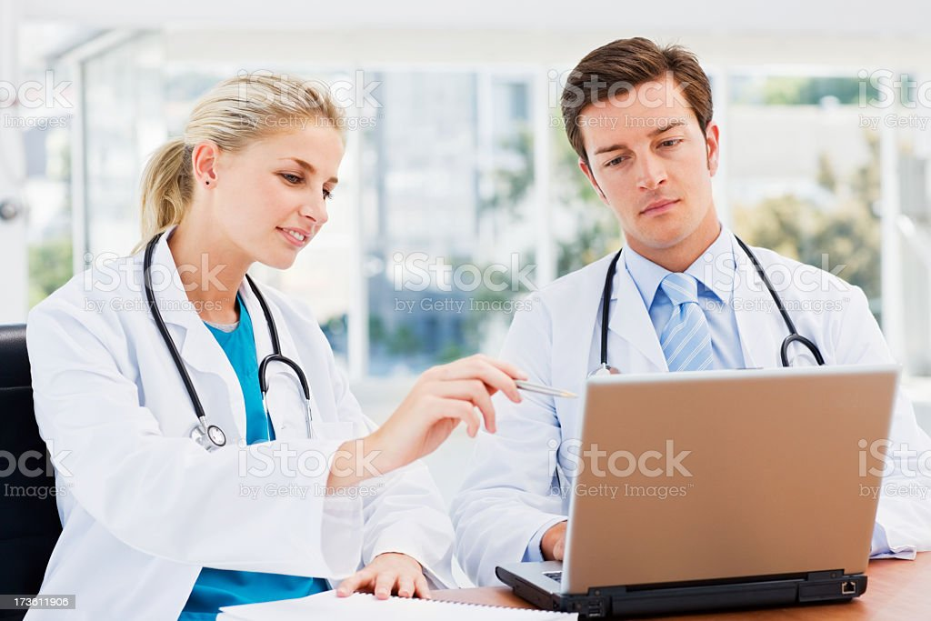 Doctors working on a laptop royalty-free stock photo