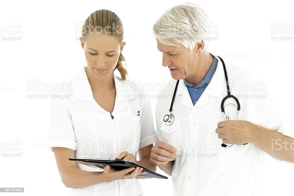 Doctors working together on clipboard stock photo
