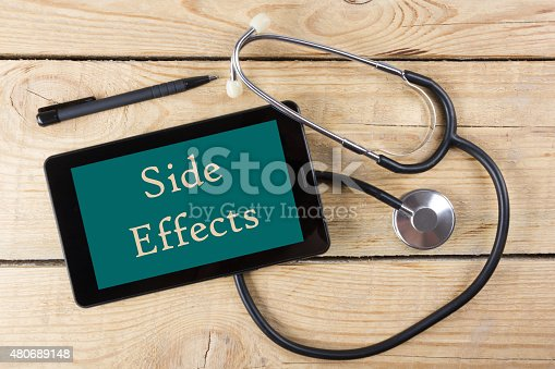 istock Doctor's workplace. Tablet, stethoscope,pen on wooden desk. Top view 480689148