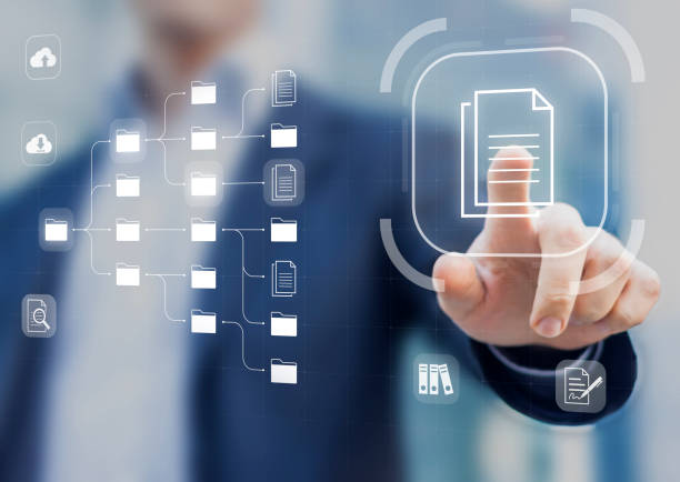Document Management System (DMS) in addition to digitization and process automation to efficiently manage files, knowledge and documentation in enterprise with ERP. Corporate business technology stock photo