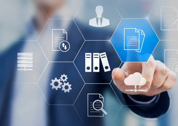 Document Management System (DMS) used to store, search and manage review process and users for corporate files and information in enterprise. Concept with business manager pointing to icons. stock photo